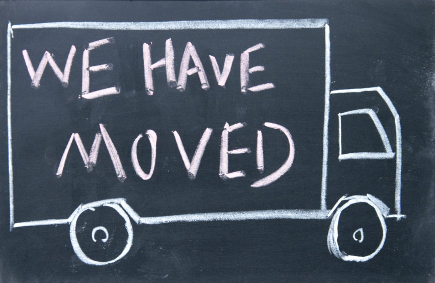 "moving truck with announcement ""We have moved"""