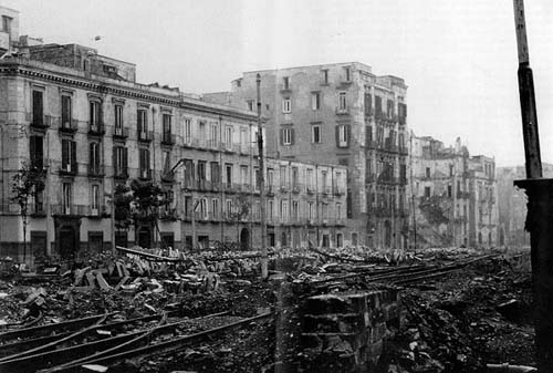 Wreckage in the dockyards at Naples, WWII, public domain from the National Archives