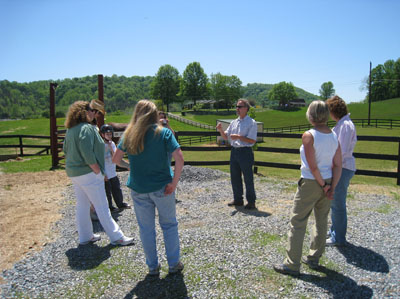 "Dr. Graham Disque and students ""on location"" during the Horses, Dogs, and Counseling course."