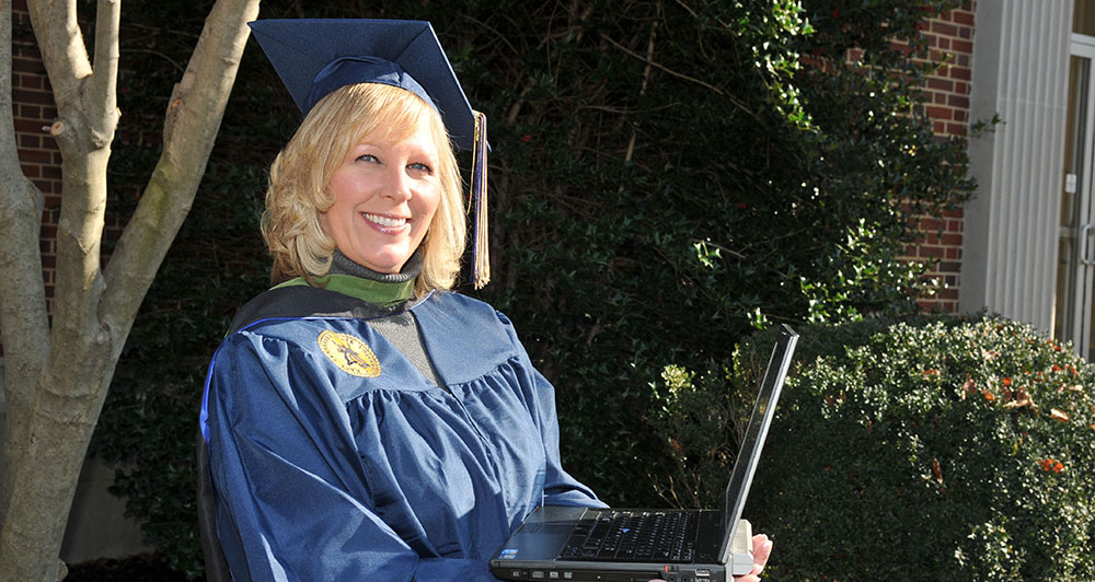 graduate with a laptop